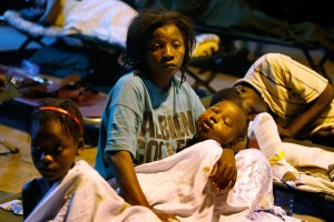 A women and her injured baby are seen at a makeshift field hospital